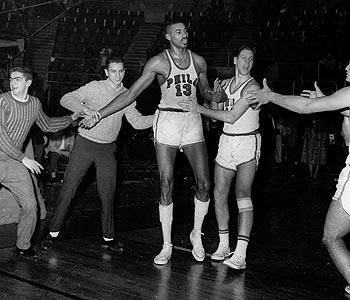 Wilt Chamberlain's 100-point game made history, but never defined the Hall of Fame center