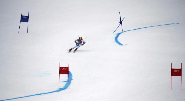 Austria's Marcel Hirscher skis during the first run of the men's alpine skiing giant slalom event at the 2014 Sochi Winter Olympics at the Rosa Khutor Alpine Center February 19, 2014. REUTERS/Leonhard Foeger (RUSSIA - Tags: SPORT SKIING OLYMPICS)