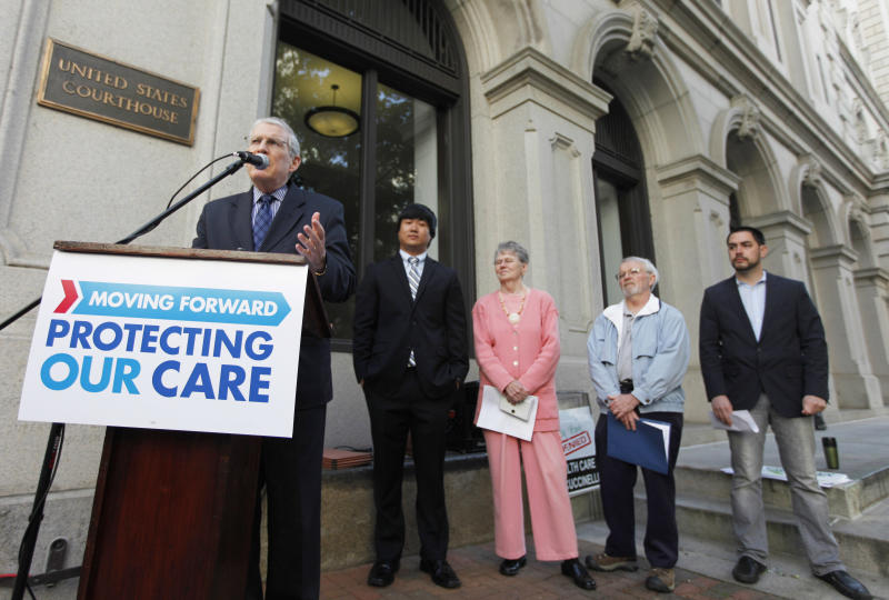 From left, supporters of President Obama's health care policies Ron Pollack, Larry Kim, Dell Erwin, Ray Scher, and Kevin Wilson hold a rally in front of federal court in Richmond, Va. Tuesday, May 10, 2011. The US 4th Circuit Court of Appeals is hearing two cases challenging the federal health care reform act. (AP Photo/Steve Helber)
