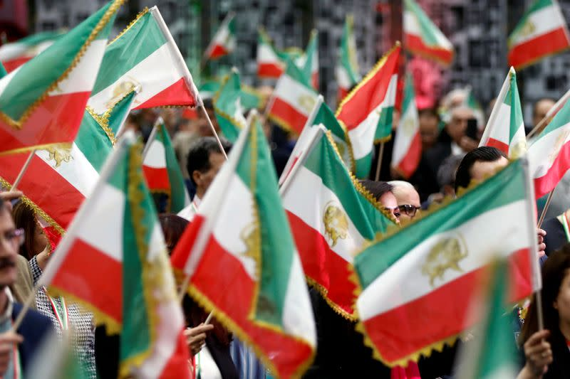 FILE PHOTO: Attendees at the California Convention for a Free Iran wave flags as Iranian Americans converge in Los Angeles