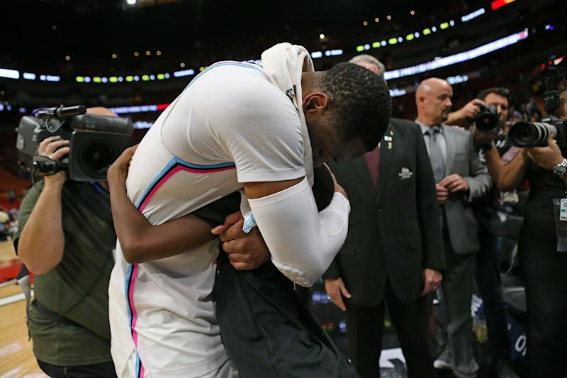 Miami Heat guard Dwyane Wade hugs his son, Zion, after a 91-85 win against the Milwaukee Bucks at the AmericanAirlines Arena in Miami on Friday, Feb. 9, 2018. (David Santiago/El Nuevo Herald/Tribune News Service via Getty Images)