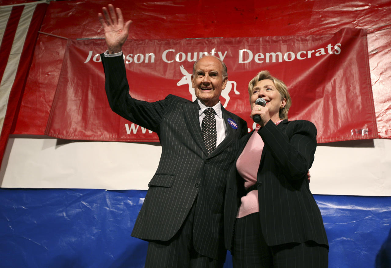 FILE - In this Oct. 6, 2007 file photo Democratic presidential hopeful, Sen. Hillary Rodham Clinton, D-N.Y., poses with former Democratic presidential candidate George McGovern before speaking at the Johnson County Democrats' annual barbecue in Iowa City, Iowa. A family spokesman says, McGovern, the Democrat who lost to President Richard Nixon in 1972 in a historic landslide, has died at the age of 90. According to a spokesman, McGovern died Sunday, Oct. 21, 2012 at a hospice in Sioux Falls, surrounded by family and friends. (AP Photo/Charlie Neibergall, File)