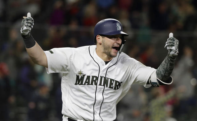 Seattle Mariners Mike Zunino celebrates after he hit a walk-off solo home run against the Minnesota Twins during the 12th inning of a baseball game, Saturday, May 26, 2018, in Seattle. The Mariners won 4-3. (AP Photo/Ted S. Warren)
