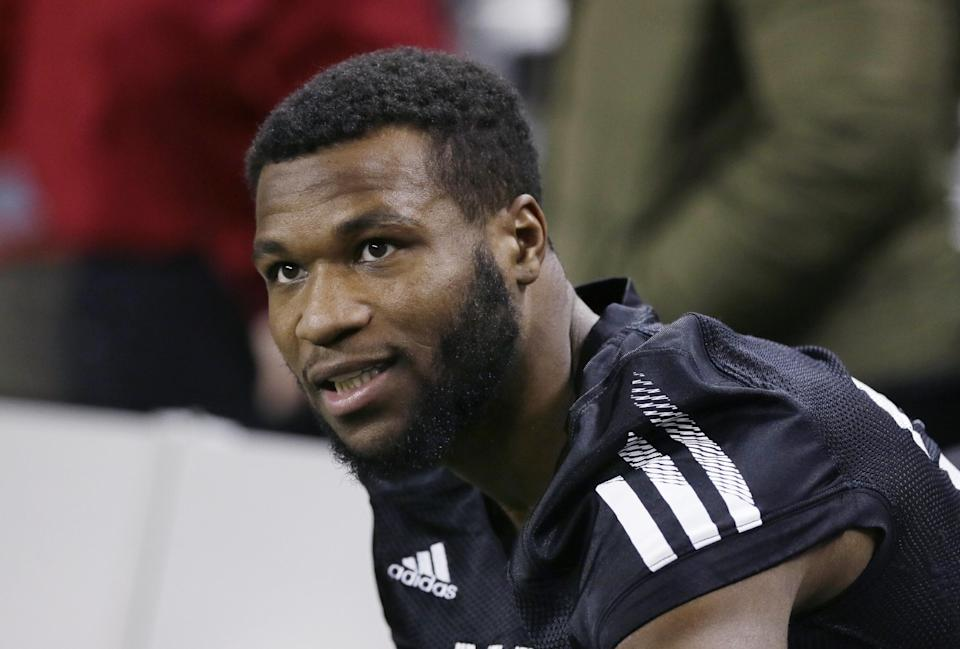 Northern Illinois cornerback Paris Logan sits on the bench during NCAA college football practice in Detroit, Thursday, Dec. 4, 2014. Northern Illinois will meet Bowling Green in the Mid-American Conference Championship at Ford Field on Friday. (AP Photo/Carlos Osorio)