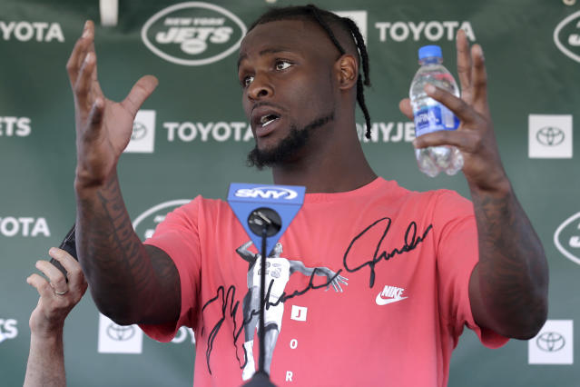 FILE - In this July 25, 2019, file photo, New York Jets running back Le'Veon Bell speaks to reporters after a practice at the NFL football team's training camp in Florham Park, N.J. Bell was in fifth grade when he realized he couldn't shake music from his mind. That's when I really realized I loved music, the star running back recalled in an interview with The Associated Press in the players' lobby in the New York Jets' facility. (AP Photo/Seth Wenig, File)
