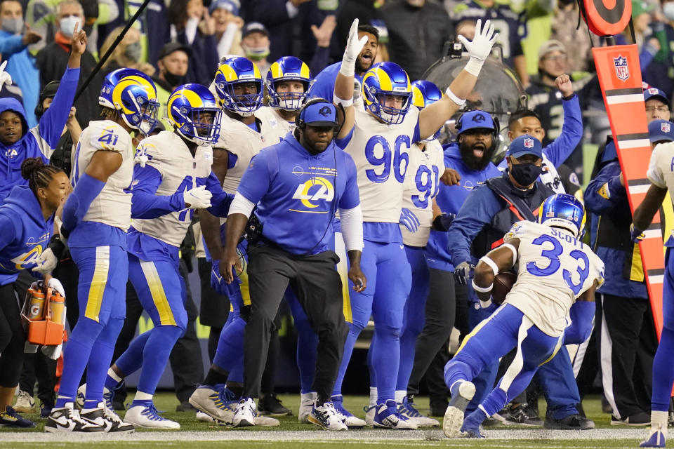Los Angeles Rams safety Nick Scott (33) intercepts a pass during the second half of an NFL football game against the Seattle Seahawks, Thursday, Oct. 7, 2021, in Seattle. The Rams won 26-17. (AP Photo/Elaine Thompson)
