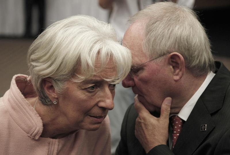 German Finance Minister Wolfgang Schuble, right, talks to the Managing Director of IMF Christine Lagarde prior of the Informal European economic and financial affairs council in capital Nicosia, Cyprus, Friday, Sept. 14, 2012. European finance ministers are gathering in Cyprus for two days of discussions about the debt crisis and the latest developments in Greece and Spain. (AP Photo/Dimitri Messinis)