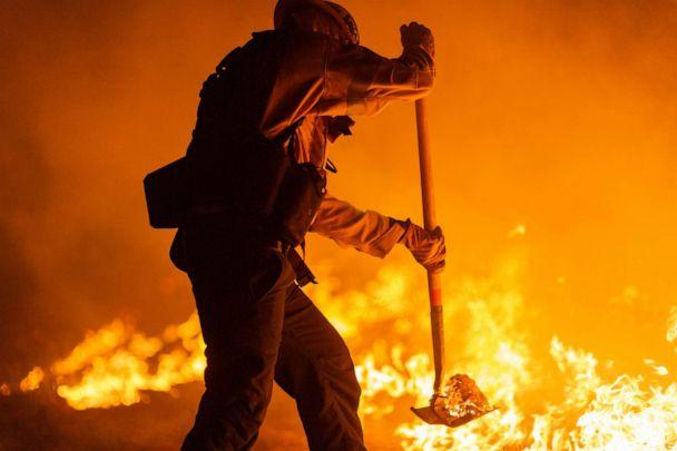 PHOTO: Los Angeles County firefighters, using only hand tools, keep fire from jumping a fire break at the Bobcat Fire in the Angeles National Forest on Sept. 11, 2020, north of Monrovia, Calif. (David Mcnew/Getty Images)