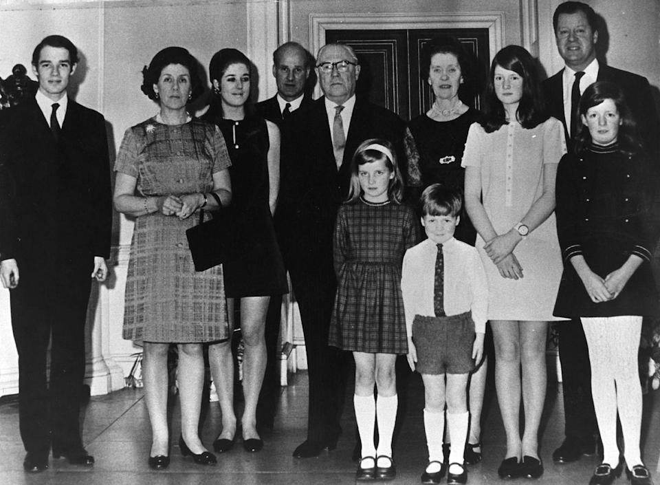 <p>A family photo taken at the 50th wedding anniversary of Diana's grandparents, the Earl and Countess Spencer. From left to right: Richard Wake-Walker, Lady Anne Wake-Walker, Elizabeth Wake-Walker, Christopher Wake-Walker, Earl Spencer, Countess Spencer, Lady Sarah Spencer, Viscount Althrop, Lady Jane Spencer. Diana Spencer and Charles Spencer stand in the front. </p>