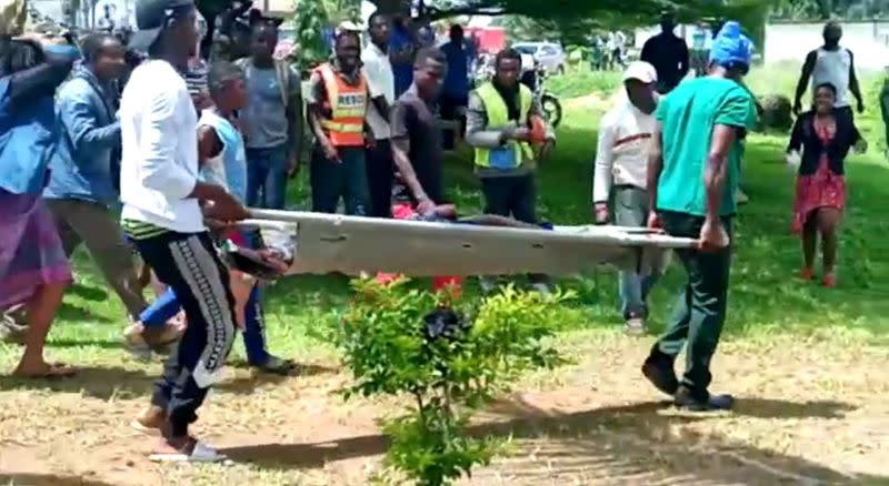 Body of a victim is carried following a shooting at a school in Kumba