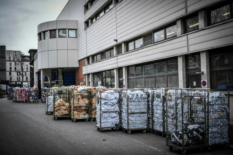 """Piles of laundry from 38 different hospitals wait their turn at the entrance to Pitie-Salpetriere's """"dirty zone"""""""