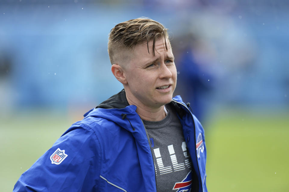 FILE - In this Oct. 6, 2019, file photo, Buffalo Bills coaching intern Callie Brownson talks with players during warmups before an NFL football game between the Bills and the Tennessee Titans in Nashville, Tenn. Brownson has been named chief of staff for new Browns coach Kevin Stefanski, who began his NFL career in a similar job. Brownson spent last season as a coaching intern with the Bills, and one of the few females in the league, which has been welcoming more women in recent years. (AP Photo/Mark Zaleski, File)