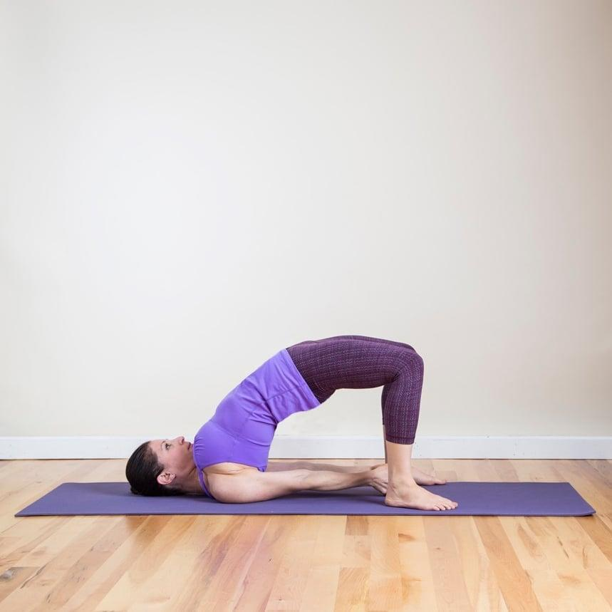 <ul> <li>From Seated Clasping Neck Stretch, lie on your back with your knees bent and feet hips-width apart.</li> <li>Lift your hips off the ground by pressing into your feet. Support your hips by pressing your hands into your lower back with the elbows on the floor underneath your hips. </li> <li>For a deeper stretch, clasp your hands together underneath you, squeezing your shoulder blades together. </li> <li>Hold for five breaths.</li> </ul>
