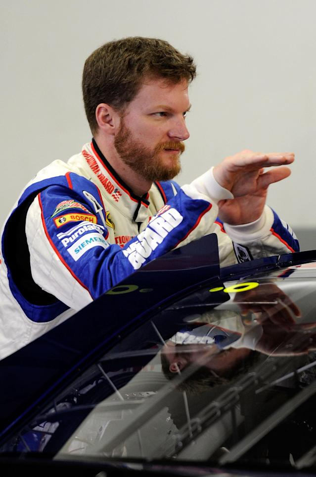 DAYTONA BEACH, FL - FEBRUARY 17: Dale Earnhardt Jr., driver of the #88 Diet Mountain Dew/National Guard Chevrolet, talks in the garage during practice for the NASCAR Budweiser Shootout at Daytona International Speedway on February 17, 2012 in Daytona Beach, Florida. (Photo by John Harrelson/Getty Images for NASCAR)