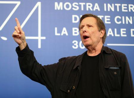 "FILE PHOTO: Director William Friedkin gestures as he poses during a photocall for the movie ""The Devil and the Father Amorth"" at the 74th Venice Film Festival in Venice, Italy August 31, 2017. REUTERS/Alessandro Bianchi"