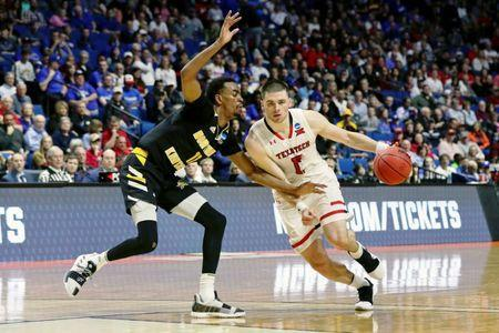 Mar 22, 2019; Tulsa, OK, USA; Texas Tech Red Raiders guard Matt Mooney (13) dribbles around Northern Kentucky Norse guard Jalen Tate (11) during the second half in the first round of the 2019 NCAA Tournament at BOK Center. The Texas Tech Red Raiders won 72-57. Mandatory Credit: Brett Rojo-USA TODAY Sports