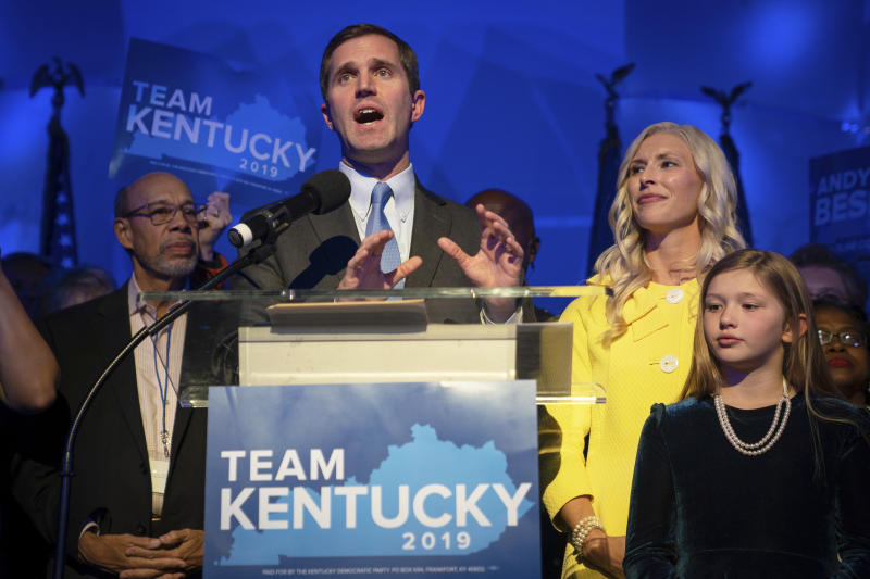 Kentucky Attorney General and democratic Gubernatorial Candidate Andy Beshear stands with his wife, Britainy, right, as he delivers a victory speech at the Kentucky Democratic Party election night watch party, Tuesday, Nov. 5, 2019, in Louisville, Ky. (Photo: Bryan Woolston/AP)