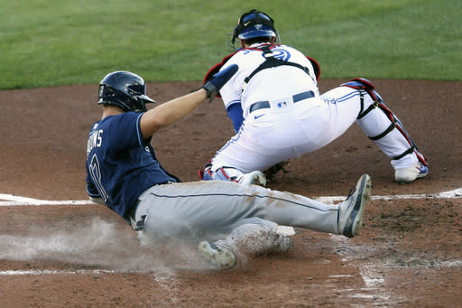 Tampa Bay Rays' Austin Medows is safe at home on a ball hit by Brandon Lowe during the second inning of a baseball game against the Toronto Blue Jays, Friday, Aug. 14, 2020, in Buffalo, N.Y. (AP Photo/Jeffrey T. Barnes)