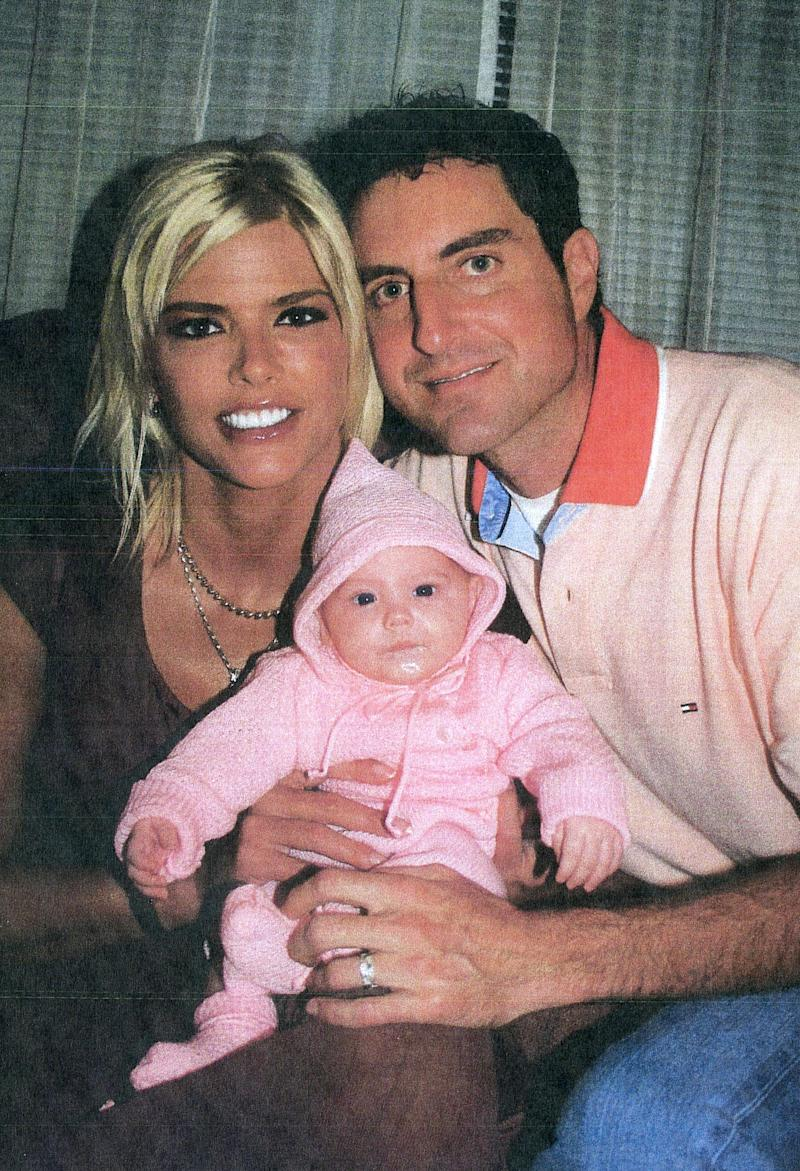 This image provided by the Los Angeles County Superior Court shows Anna Nicole Smith with her daughter, Dannielynn and Howard K. Stern. Suggesting pictures are more powerful than words, the defense in the Anna Nicole Smith drug conspiracy case put on a slide show for jurors Friday of 90 photos depicting the last five months of the former Playboy model's life. With defense lawyers planning to call no witnesses after the prosecution rests its case Monday, the photos were their only evidence, designed to show Smith was not impaired by drugs as witnesses have testified.(AP Photo/ Los Angeles County Superior Court)
