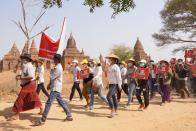 Demonstrators march during a protest against the military coup, near temples in Bagan
