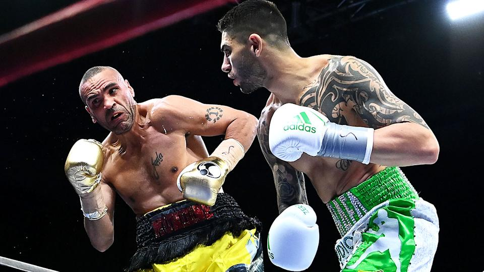 Pictured here, Anthony Mundine gets punched in his fight against Michael Zerafa.