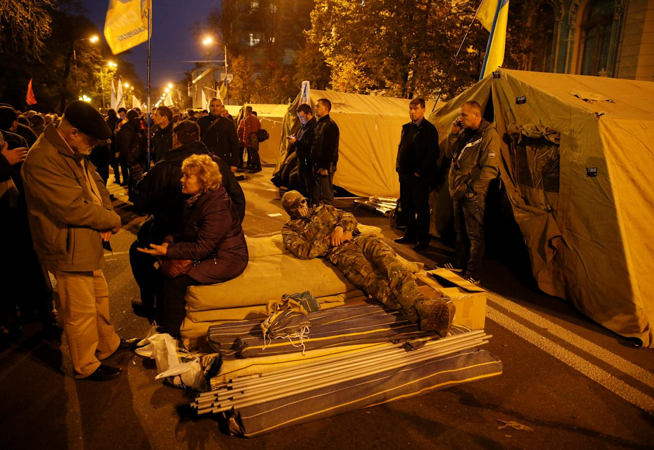 Protesters are seen near tents during a rally to demand an electoral reform, in front of the Ukrainian parliament in Kiev, Ukraine October 17, 2017. REUTERS/Valentyn Ogirenko