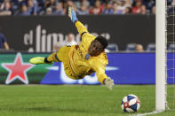 New York City FC goalkeeper Sean Johnson dives for a ball shot on goal during the second half of an MLS soccer match against Toronto FC Wednesday, Sept. 11, 2019, in New York. The game ended in a 1-1 draw. (AP Photo/Frank Franklin II)