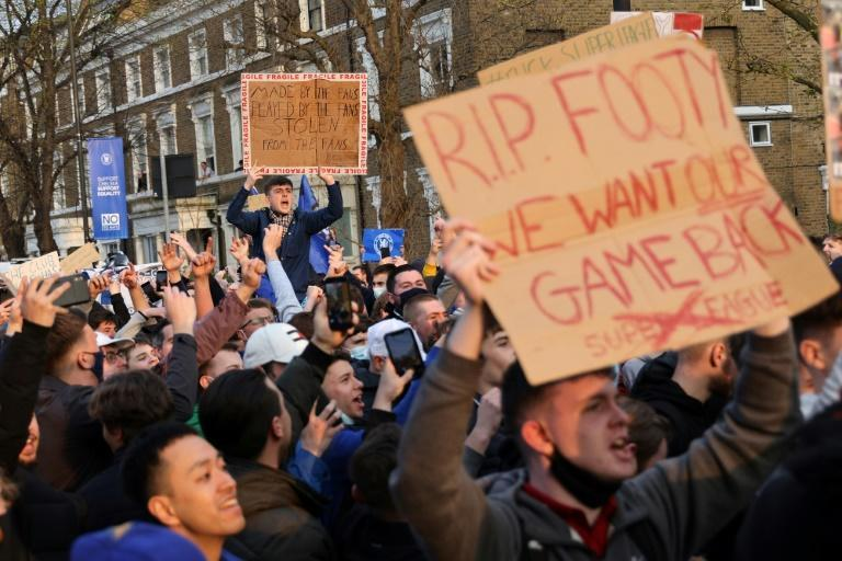 Football fans demonstrate against the proposed European Super League outside Chelsea's Stamford Bridge football stadium in London