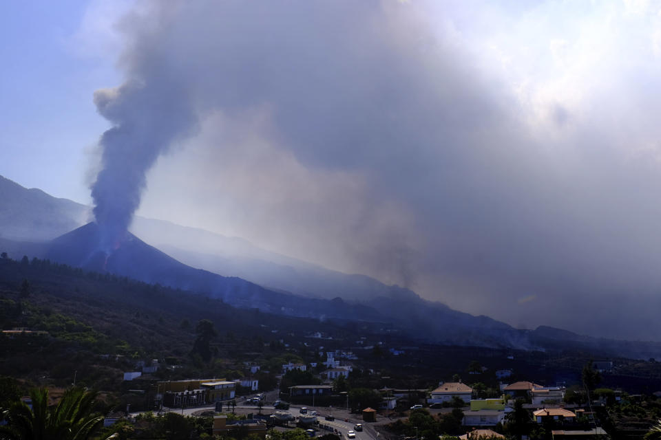 A volcano continues to erupt near El Paso on the canary island of La Palma, Spain, Saturday Oct. 9, 2021. A new lava flow has belched out from the La Palma volcano and it threatens to spread more destruction on the Atlantic Ocean island where molten rock streams have already engulfed over 1,000 buildings. The partial collapse of the volcanic cone overnight sent a new lava stream Saturday heading toward the western shore of the island. (AP Photo/Daniel Roca)