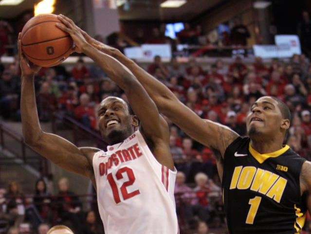 Iowa's Gabriel Olaseni, right, fouls Ohio State's Sam Thompson during the second half of an NCAA college basketball game Sunday, Jan. 12, 2014, in Columbus, Ohio. Iowa beat Ohio State 84-74. (AP Photo/Jay LaPrete)