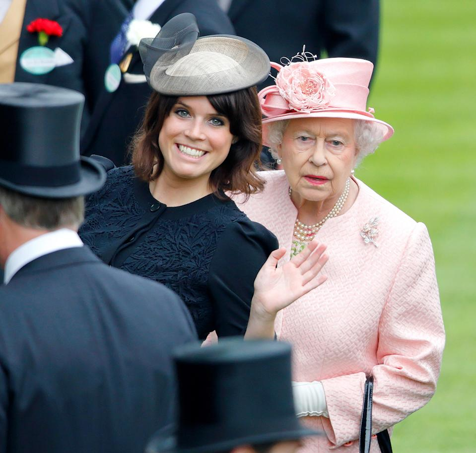 ASCOT, UNITED KINGDOM - JUNE 18: (EMBARGOED FOR PUBLICATION IN UK NEWSPAPERS UNTIL 48 HOURS AFTER CREATE DATE AND TIME) Princess Eugenie and Queen Elizabeth II attend Day 1 of Royal Ascot at Ascot Racecourse on June 18, 2013 in Ascot, England. (Photo by Max Mumby/Indigo/Getty Images)