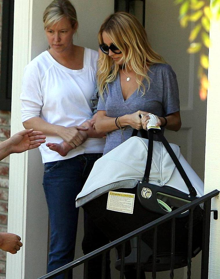 """Nicole Richie has curbed her partying ways since giving birth to daughter Harlow in January. Here, mother and daughter are spotted exiting an afternoon soiree. Lins-APG-AlphaX/<a href=""""http://www.x17online.com"""" target=""""new"""">X17 Online</a> - March 28, 2008"""