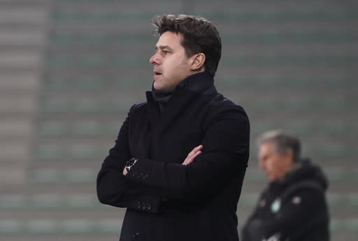 PSG's head coach Mauricio Pochettino watches from the touchline during the French League One soccer match between Saint-Etienne and Paris Saint-Germain at the Geoffroy Guichard stadium, in Saint-Etienne, central France, Wednesday, Jan. 6, 2021. (AP Photo/Laurent Cipriani)