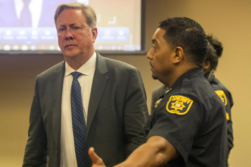 Former DeKalb County police officer Robert Olsen becomes prepares to be processed after his sentencing, Friday, Nov. 1, 2019, in Decatur, Ga. Olsen, who was convicted of aggravated assault and other crimes in the fatal shooting of an unarmed, naked man, was sentenced Friday to 12 years in prison.. (Alyssa Pointer/Atlanta Journal-Constitution via AP)