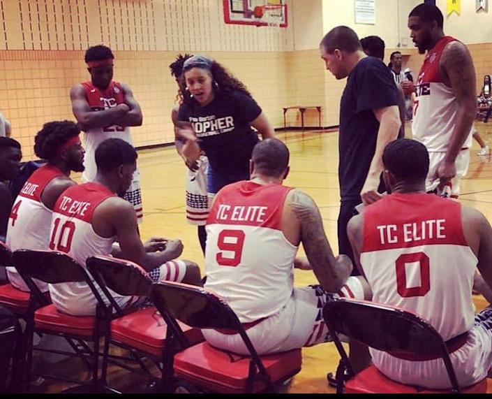 Tamara Moore, a college basketball standout who played five years in the WNBA, is shown here coaching one of the men's semi-pro teams in the league she founded, the Official Basketball Association. This year, Moore became the first Black woman to be named a coach of a men's collegiate basketball program.