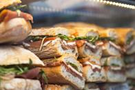"""<p>Yes, it can be hard to resist the temptation of the deli counter, but know that doing so could save you some money. According to Mashed, for the price of one deli sandwich, you can often <a href=""""https://www.mashed.com/100838/surprising-truth-grocery-stores-deli-counter/"""" rel=""""nofollow noopener"""" target=""""_blank"""" data-ylk=""""slk:purchase the ingredients to make that same sandwich three times over."""" class=""""link rapid-noclick-resp"""">purchase the ingredients to make that same sandwich three times over.</a> Keep walking past the counter, and pick up the individual ingredients instead. </p>"""