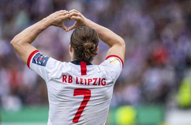 Leipzig's Marcel Sabitzer celebrates his side third goal during the German soccer cup, DFB Pokal, first Round match between VfL Osnabrueck - RB Leipzig in Osnabrueck, Sunday, Aug. 11, 2019. (Guido Kirchner/dpa via AP)