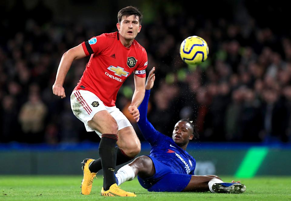 Manchester United's Harry Maguire (left) scored one of the two goals to beat Michy Batshuayi and Chelsea, but not without some help from VAR. (Photo by Mike Egerton/PA Images via Getty Images)