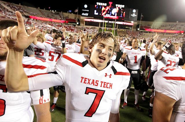 FILE - In this Sept. 21, 2013 file photo, Texas Tech's Davis Webb (7) celebrates a win over Texas State after the NCAA college football game in Lubbock, Texas. Last season true freshman Davis Webb battled to become Texas Tech starting quarterback. He ended the season with a stellar performance and the MVP in the Red Raiders Holiday Bowl win. (AP Photo/Lubbock Avalanche-Journal, Stephen Spillman)
