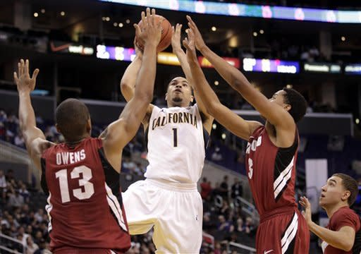California's Justin Cobbs, center, shoots as he is defended by Stanford's Josh Owens, left, and Anthony Brown during the first half of an NCAA college basketball game at the Pac-12 conference championship in Los Angeles, Thursday, March 8, 2012. (AP Photo/Jae C. Hong)