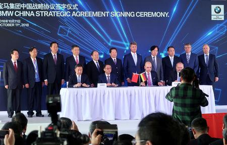 Harald Krueger, BMW Chief Executive, and Chen Qiufa, Communist Party Secretary of Liaoning province attend a signing and a ground breaking ceremony for a new assembly plant, inside the BMW Brilliance Plant Tiexi, in Shenyang, Liaoning province, China October 11, 2018. REUTERS/Norihiko Shirouzu