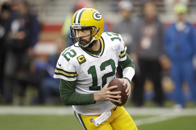 Green Bay Packers quarterback Aaron Rodgers (12) rolls out during the first half of the NFL NFC Championship football game against the San Francisco 49ers Sunday, Jan. 19, 2020, in Santa Clara, Calif. (AP Photo/Ben Margot)