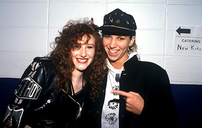 Tiffany and Debbie Gibson pose backstage at a New Kids on the Block concert in 1989.
