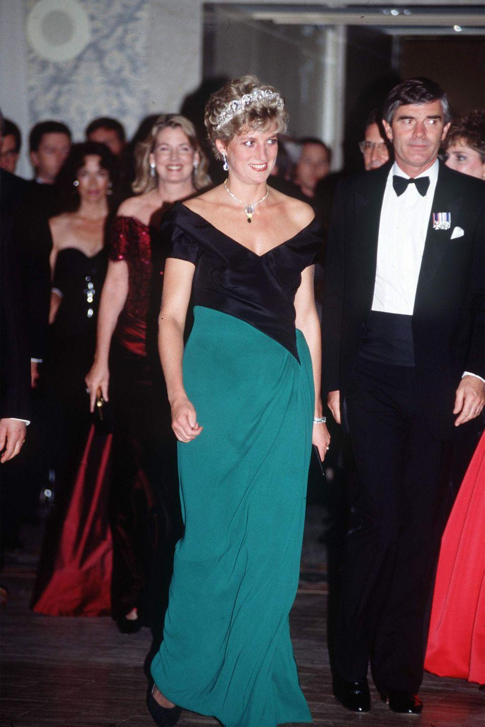 <p>In a black-and-green crepe dress by Catherine Walker at a dinner in Toronto, Canada. </p>