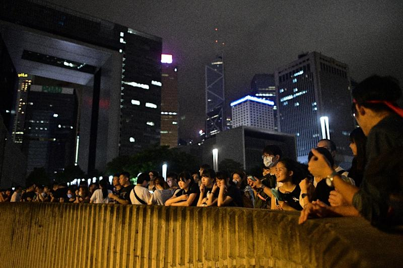 People gather outside the government headquarters in Hong Kong late on June 11, 2019, just hours before lawmakers debate a divisive plan to allow extraditions to China (AFP Photo/Anthony WALLACE)