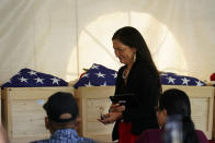 Interior Secretary Deb Haaland moves to speak during a ceremony at the U.S. Army's Carlisle Barracks, in Carlisle, Pa., Wednesday, July 14, 2021. The disinterred remains of nine Native American children who died more than a century ago while attending a government-run school in Pennsylvania were headed home to Rosebud Sioux tribal lands in South Dakota on Wednesday after a ceremony returning them to relatives. (AP Photo/Matt Rourke)