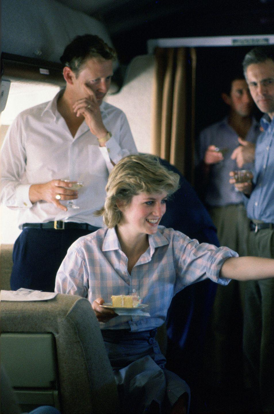<p>Aboard an Australian Air Force Plane, Princess Diana held an impromptu birthday party for the valet. </p>