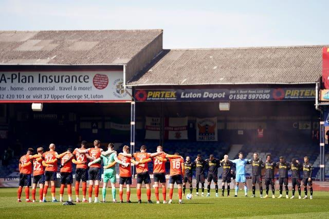 Ahead of their clash, local rivals Luton and Watford stood together in memory