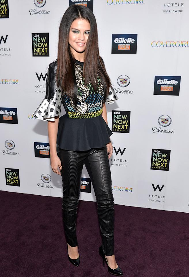 "Selena Gomez rocked the red carpet upon arriving at the 2013 NewNowNext Awards in Hollywood, California, on Saturday evening. From her fabulous, peplum-enhanced Peter Pilotto blouse to her equally fierce Giuseppe Zanotti pumps -- and everything in-between, including black leather Plein Sud pants -- the ""Spring Breakers"" star's head-to-toe ensemble was hot to trot. Green eyeshadow and flat-ironed tresses completed her flawless look. (4/13/2013)"