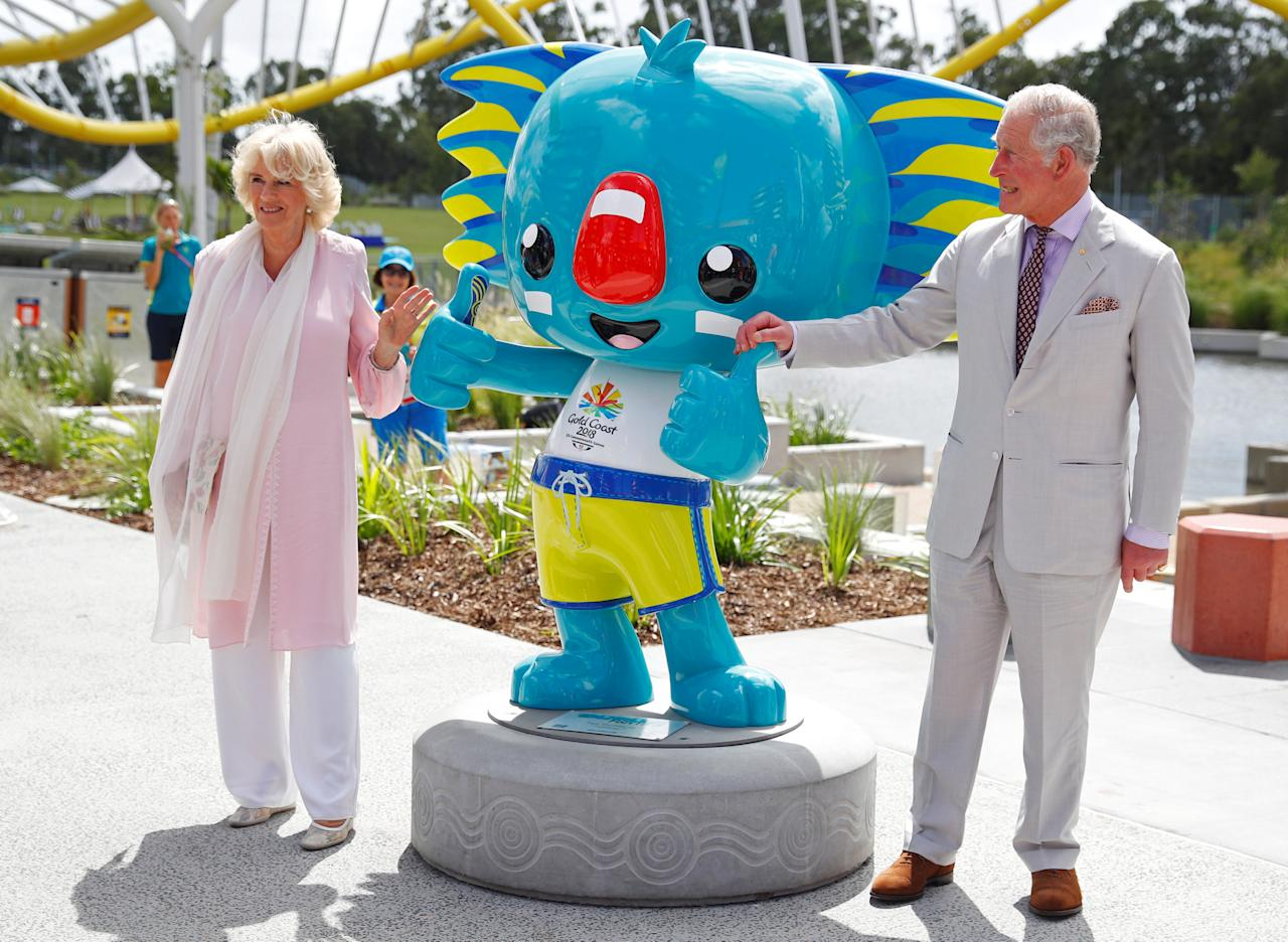 <p>The Prince of Wales and the Duchess of Cornwall with the games mascot Borobi during a visit the Commonwealth Games Athletes' Village in Gold Coast, Australia. (PA) </p>